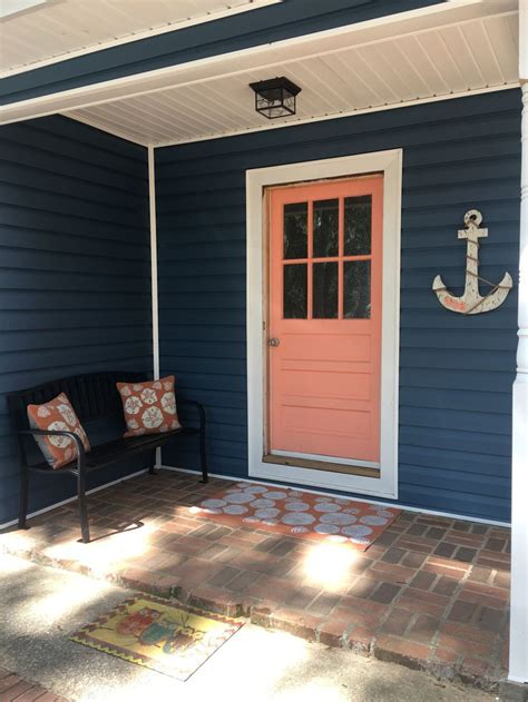 heritage blue siding coral front door house paint