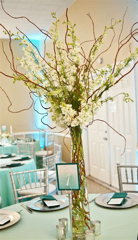 willow arrangement tall white and green centerpiece of curly willow with white larkspur by andrea layne floral