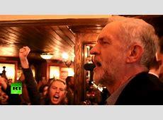 Singing socialist New Labour leader Corbyn celebrates