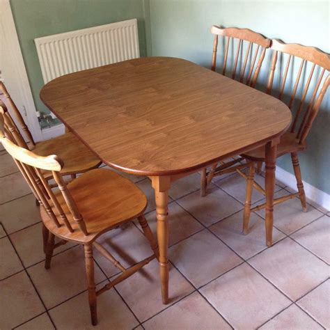 Extendable Wooden Kitchen Table With Four Chairs For Sale