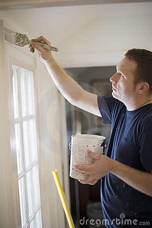 man painting wall royalty  stock photo image