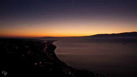 sole splendente alba sullo stretto  messina
