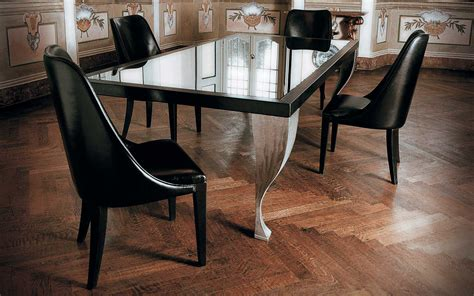 white acrylic based dining table using rectangle glass top
