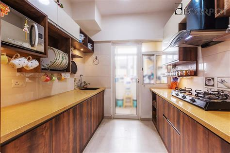 Look at design templates from multiple magazines and websites. Parallel Modular Kitchen Interior Designs in Bangalore