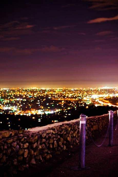 sunset city lights city lights night city photo