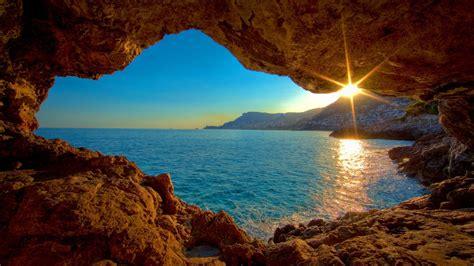 2560x1440 Sunrise Ocean Cave desktop PC and Mac wallpaper