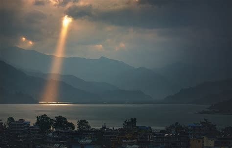 landscape nature sun rays lake dark mountain city