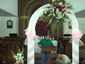 wedding arches indoor wedding decorations fresh flowers orchids lillies and