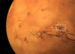 Fly through the largest canyon in the solar system ...