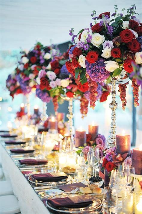 opulent wedding centerpieces of red white and purple