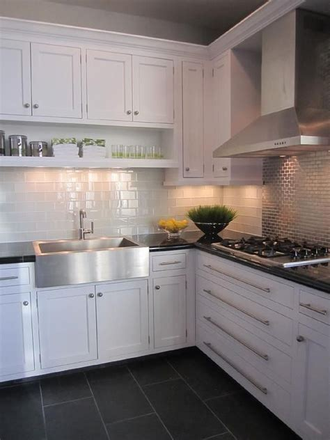 kitchen with white cabinets white glass subway tile and