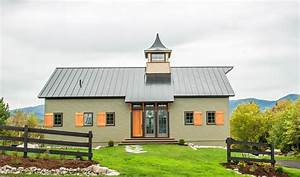 a new house built to look like an old barn With barn builders nh