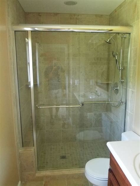 tile shower  sliding glass door bathroom