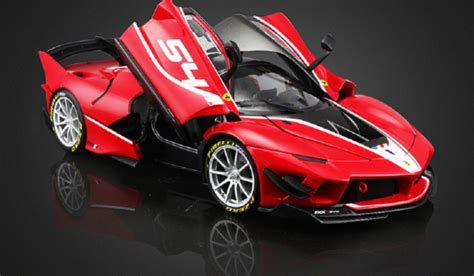 Triangular, aerodynamic vortex generators on the centre of the rear shark fin help clean the airflow off the radiators and direct it more efficiently to the fixed rear wing. Bburago Signature Series Vehicles 1:18 Diecast Ferrari FXX K FXXK EVO Car Model | eBay