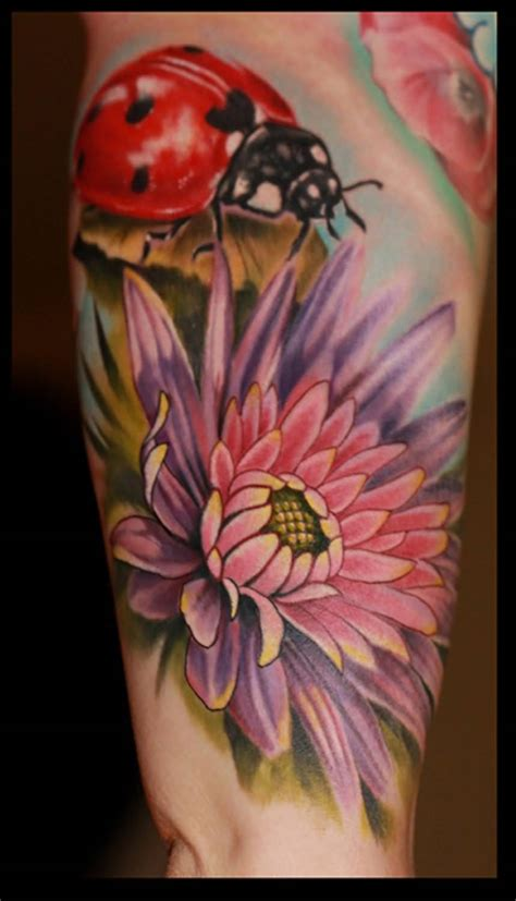 incredible ladybug  flower tattoos