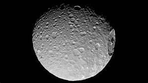 Cassini Spacecraft Views Mimas' Gigantic Crater