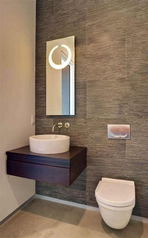 modern small powder room design featuring cool grey wood