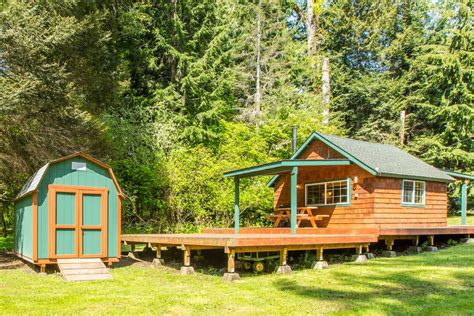 tiny house as a button at the foot of mount rainier