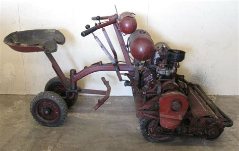 antique toro reel type riding lawn mower  sulky