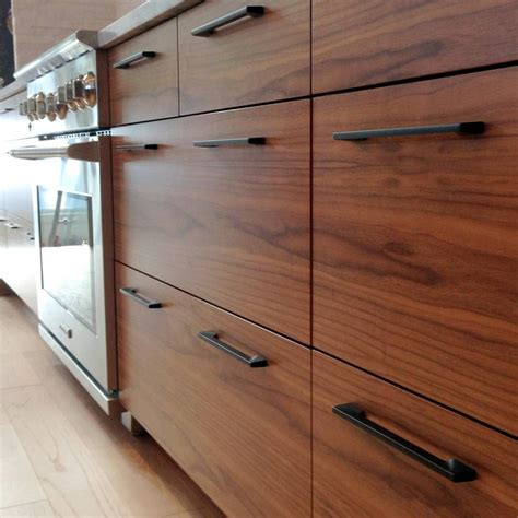 Dark Kitchen Ideas - flatsawn walnut sequence from a pretty big semihandmade ikea kitchen in canada last year