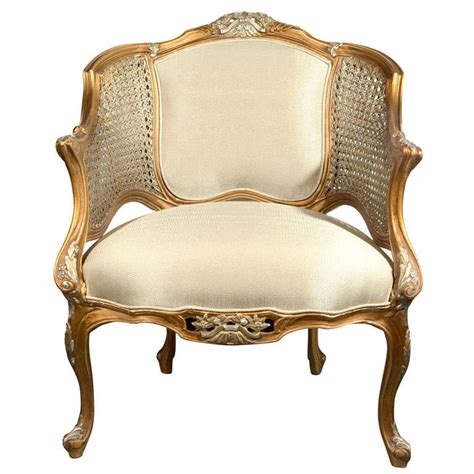 louis xiv style caned bergere chair in gilt carved