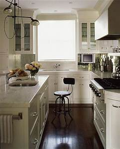 Antiqued mirrored backsplash transitional kitchen s for What kind of paint to use on kitchen cabinets for industrial chic wall art