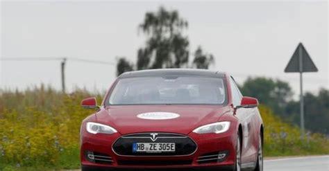 Tesla slashes Model S' price to boost sales