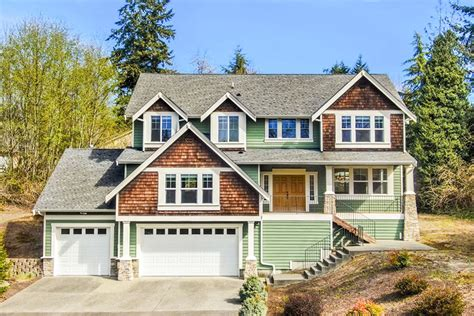 elevated craftsman house plan   front sloping lot