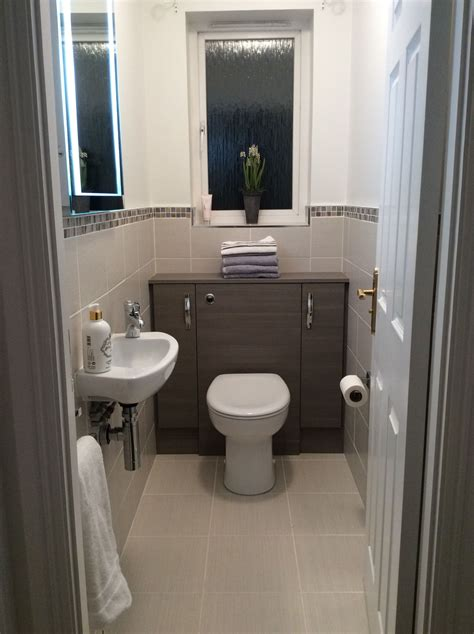 Ideas Small Cloakrooms by Small Cloakroom Grey Lined Wall And Floor Tiles Edged