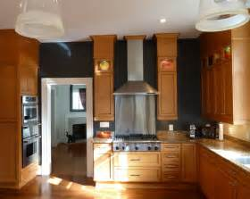 black walls in the kitchen with oak cabinets needs a lot