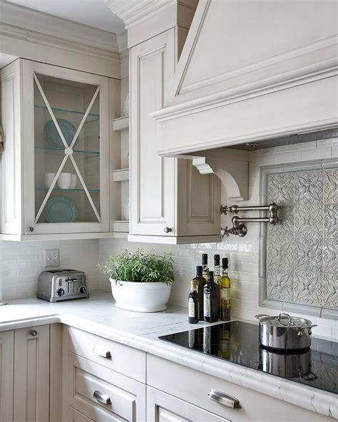 kitchen backsplash with cabinets gray mosaic cooktop backsplash traditional kitchen