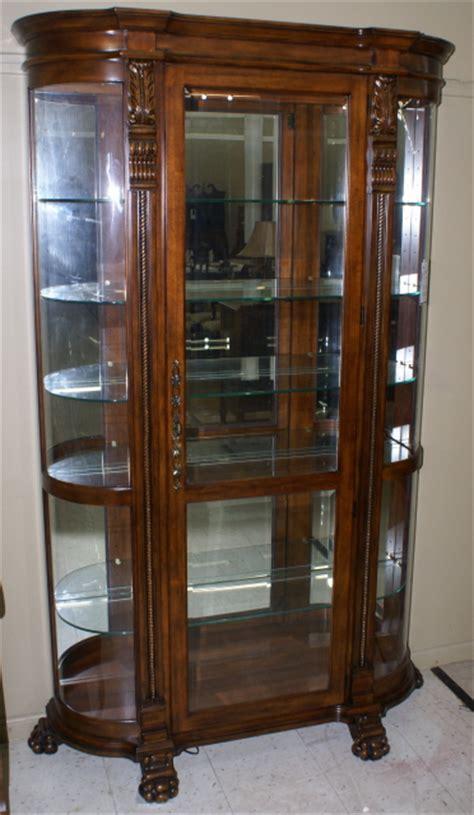 curved  paw foot dark mahogany curio cabinet  pulaski