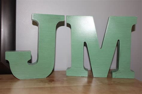wooden block letters  wal mart  michaels painted teal   thickcoarse paintbrush sand