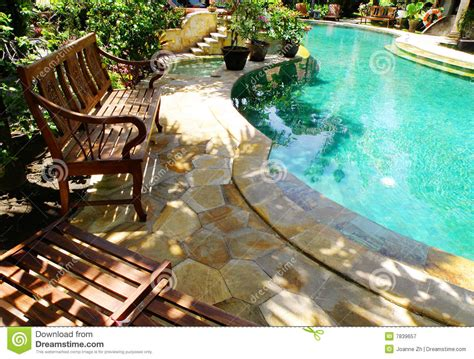 sunny outdoor swimming pool  patio furniture royalty