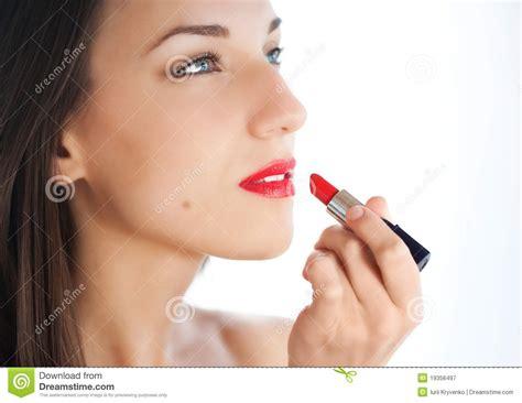 Young Woman Applying Lipstick Stock Image - Image: 19356497
