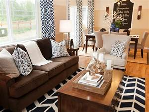 photos hgtv With black and brown furniture in living room