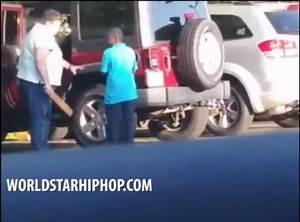 Child Abuse? Woman Beats Her Alleged Adopted Son With A Paddle In A Parking Lot!