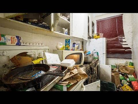 Abandoned Apartment Building With Power and a Filthy Hoarder Unit Inside!!