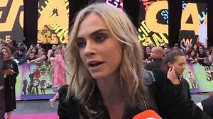 Cara Delevingne poses at Suicide Squad premiere in London