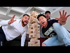 WORLD'S LARGEST GAME OF JENGA!!! (FIRST TO MAKE TOWER FALL DOWN LOSES)