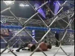 WWE Eddie Guerrero jumps on JBL from a steel cage