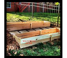 How to build a raised bed garden on a slope Video