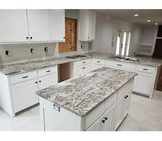 White cabinets with grey granite Video