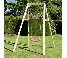 Wooden single swing and slide set Video
