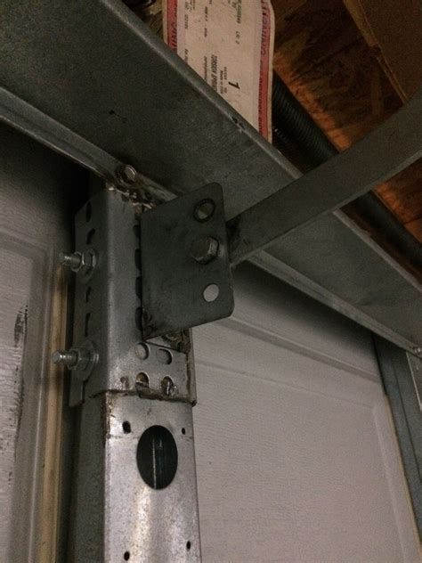 broken garage door opener arm bracket   transfer